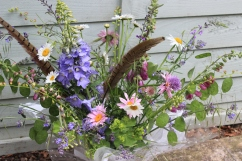 Hand-tied gift bouquet with feathers and British flowers