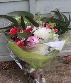 Gift wrapped gerbera and peony birthday bouquet