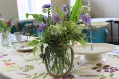 Jam jar posy flowers, afternoon tea flowers, cake plats and vintage table linens